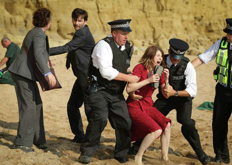 A mom (Jodie Whittaker) breaks down when she realizes it's her boy who has been murdered, while detectives (David Tennant and Olivia Colman) do their best to examine the evidence in 'Broadchurch.' Photo: Patrick Redmond +353872600976, BBC / San Antonio Express-News
