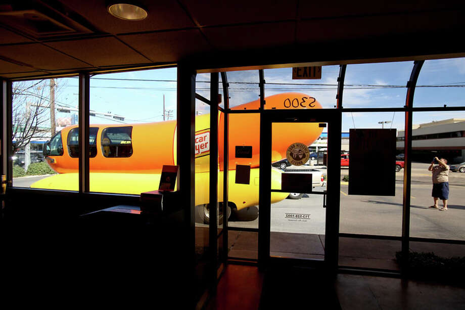 The Weinermobile visited Houston in January 2013:  Keith Buriwek, from Houston takes a photo of  the Oscar Mayer Weinermobile that was parked at Einstein Bagels. Photo: Thomas B. Shea, For The Chronicle / © 2012 Thomas B. Shea