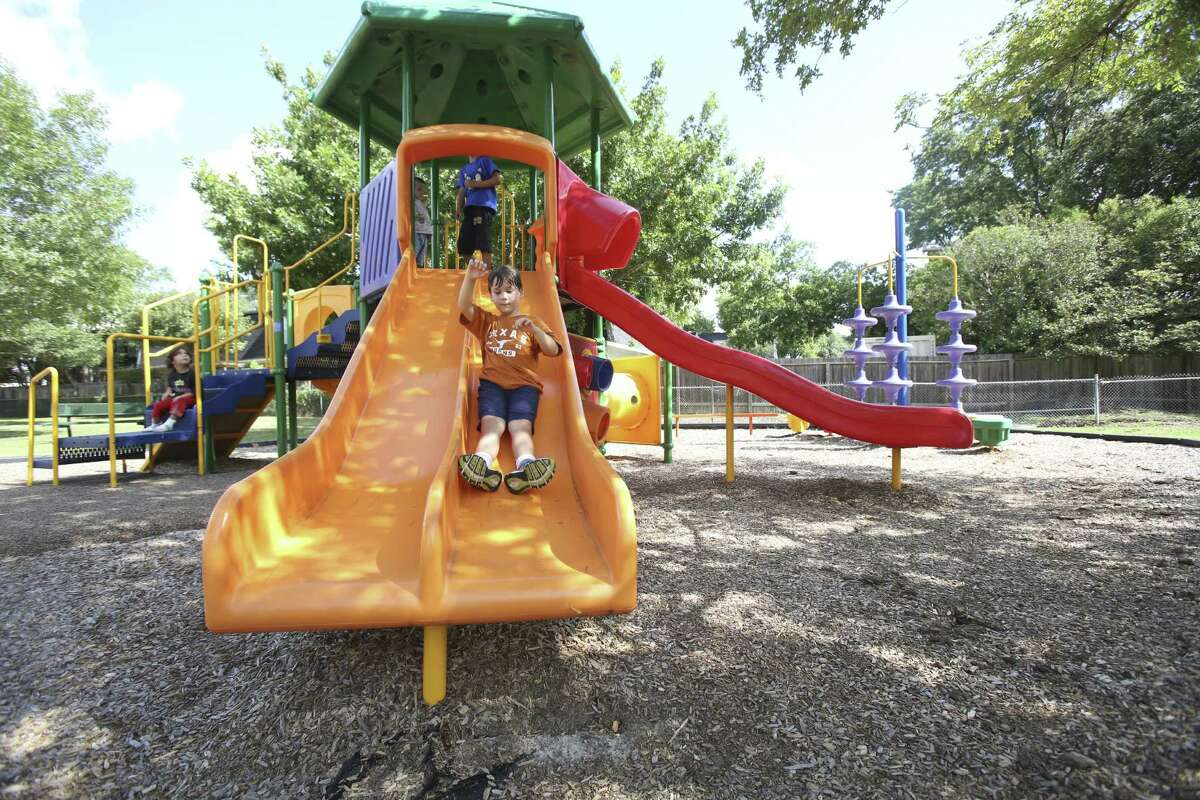 Joel Rodriguez has fun at Olympia Park. Experts say safe play areas are important to children's health.