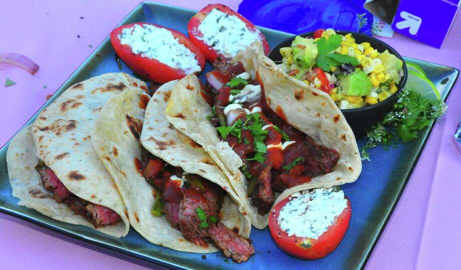 Kristin Sica of Saratoga Springs is a Times Union Grill Games finalist with her steak fajitas, spicy chipotle mole, goat cheese-stuffed roasted tomato, roasted corn salad, cilantro-lime vinaigrette. (Times Union photo)