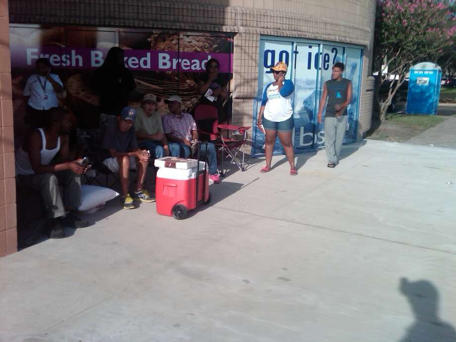 People wait in line for the 99 Cents Only Store to open on W. Greens Road in Houston, July 31. (Sarah Correa photo)