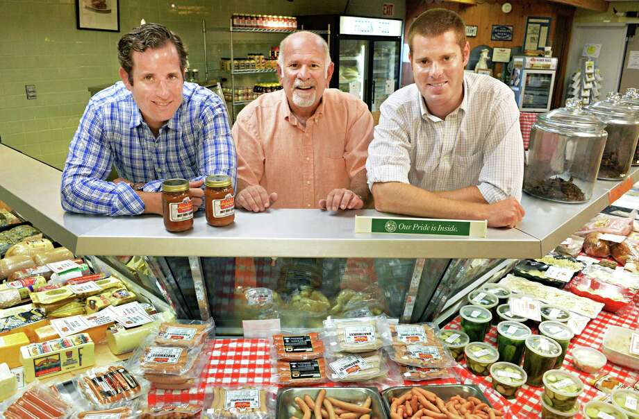 Father Seth Shuket and sons Mark Shuket, left, and Ross Shuket, at right, owners of  Helmbold's Market at their store counter in Troy, NY Tuesday July 16, 2013.  (John Carl D'Annibale / Times Union) Photo: John Carl D'Annibale / 00023092A