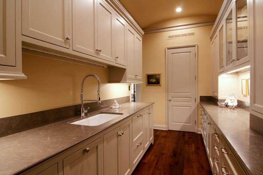 Hidden beside the kitchen is the Butler's Pantry, featuring a second dishwasher and abundant cabinet and counter space.