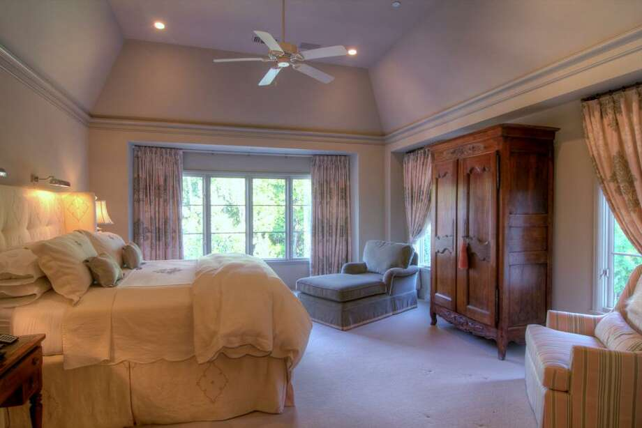 The Master Suite is sequestered down a hallway on the second floor. The bedroom and sitting area are enhanced by tall casement windows which overlook the swimming pool and lawn.