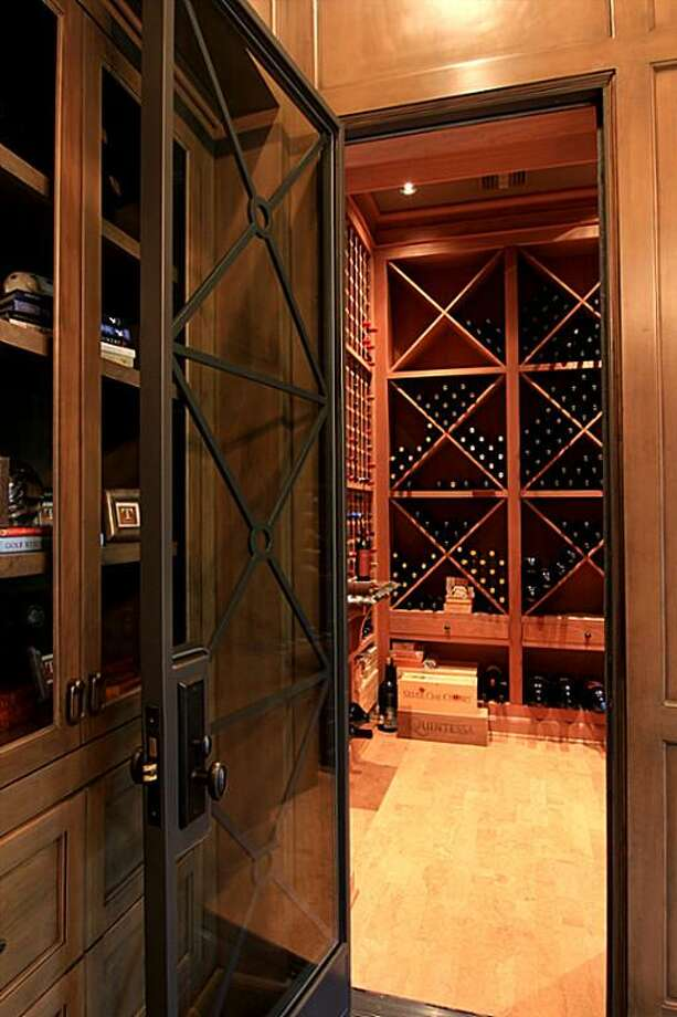 The custom built temperature controlled Wine Cellar with a tasting shelf will surely please the most demanding connoisseur.
