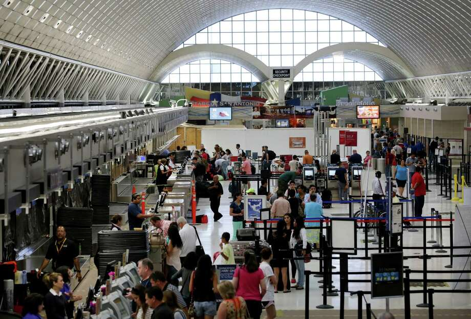 Because of ongoing renovations at Terminal A of the San Antonio International Airport, the security checkpoint area has been temporarily moved, on Tuesday, July 30, 2013. Photo: Bob Owen, San Antonio Express-News / © 2012 San Antonio Express-News