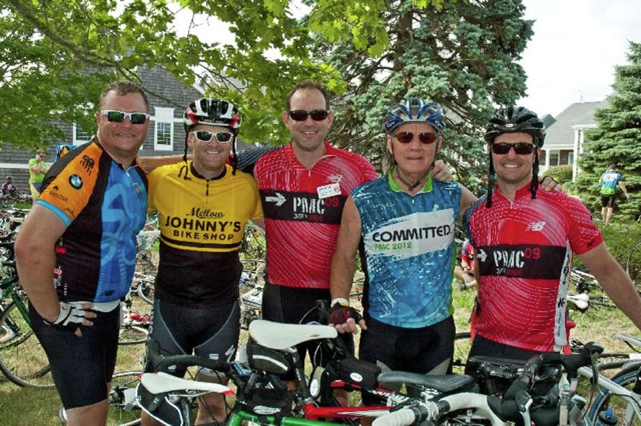Darien resident Terry Bock, far left, will compete in the 34th annual Pan-Mass challenge this weekend. He's pictured with his friend, Bobby Gaudreau; his cousin,Tom Fay; his uncle, Bruce Stevens; and his brother-in-law, Garrick Myers, at last year's event. Photo: Contributed Photo