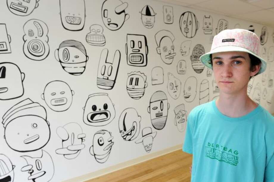 Phil Post, an 18-year-old Norwalk designer and founder of Dertbag, recently opened his first U.S. retail store in the Arcade Mall in Bridegport. Photo: Ned Gerard, Norwalk Citizen