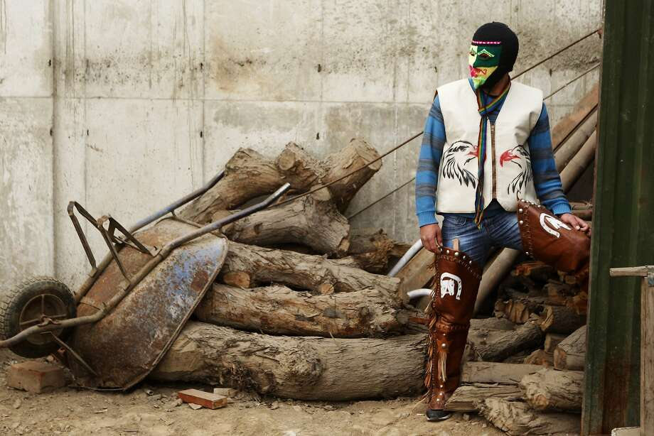 Payback  in Peru: Masked fighter Alejandro Alvaro prepares for ritual Andean combat known 