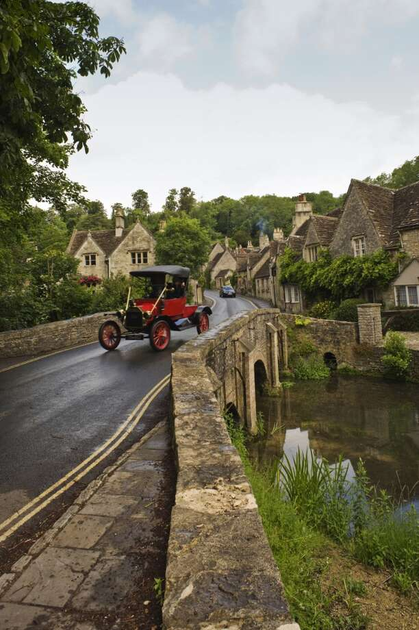 Model T Ford passing over bridge into village. Photo: John Hay, Getty Images/Lonely Planet Images