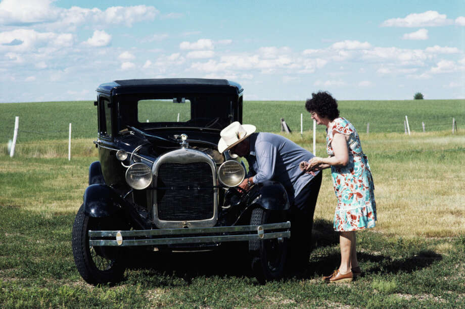 Mature couple looking under hood of antique auto, side view Photo: Bread And Butter, Getty Images / (c) Bread and Butter