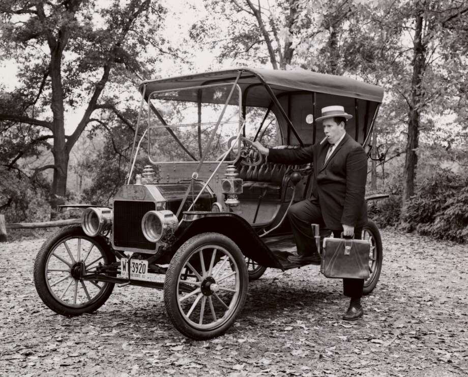 Businessman standing beside Ford Model T, 1910 Photo: SuperStock, Inc., Www.jupiterimages.com