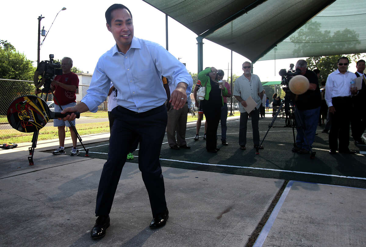 San Antonio mayor Julian Castro gets active with a paddle and ball Wednesday July 31, 2013 after a press conference at Collins Gardens Park. During the press conference, it was announced that the obesity rate in San Antonio and Bexar County has gone down from 35.1 percent to 28.5 percent between 2010 and 2012.