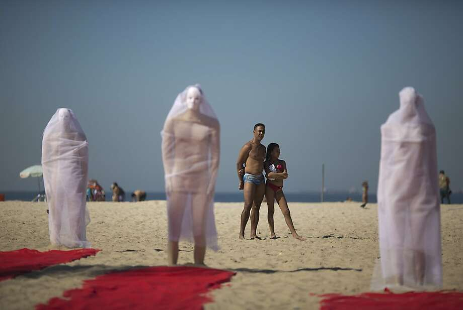 Brazil's 'disappeared': Wrapped in veils, mannequins stand on Copacabana beach in a protest by Rio de Paz activists demanding information on missing persons, including a bricklayer and father of six who recently disappeared after being picked up by police. Police questioned the man about suspected involvement in drug trafficking and then released him. He has not been seen since. Rio de Paz cites official statistics showing that nearly 35,000 people have been reported as missing in Rio state alone over the past five years. Photo: Felipe Dana, Associated Press