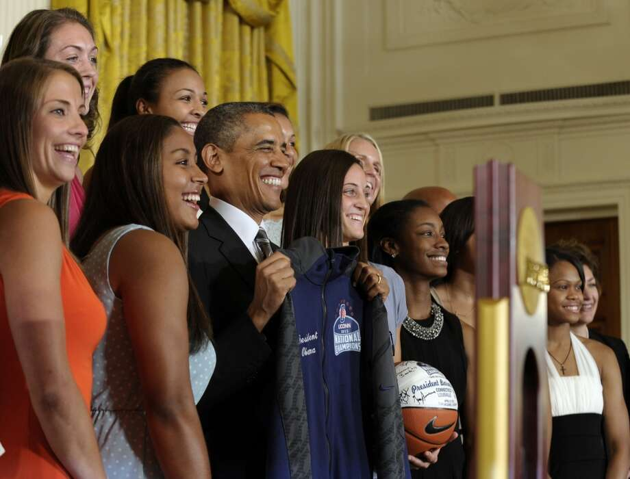 President Barack Obama poses for a photo with the 2013 NCAA Women's Basketball Champion team, the University of Connecticut Huskies, Wednesday, July 31, 2013, during a ceremony in the East Room of the White House in Washington. (AP Photo/Susan Walsh) Photo: Associated Press