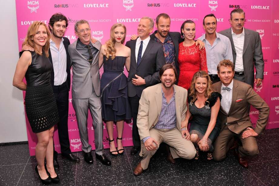 "(Top L-R) Laura Rister, Adam Brody, Jeffrey Friedman, Amanda Seyfried, Rob Epstein, Peter Sarsgaard, Debi Mazar, Hank Azaria, Chris Noth, (bottom L-R) Jim Young, Heidi Jo Markel and Brian Gattas attend The Cinema Society and MCM with Grey Goose screening of Radius TWC's ""Lovelace"" at MoMA on July 30, 2013 in New York City.  (Photo by Stephen Lovekin/Getty Images) Photo: Stephen Lovekin, Getty Images"