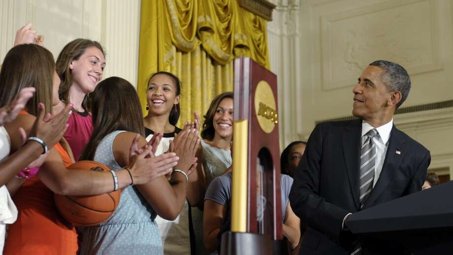 President Barack Obama looks back at University of Connecticut basketball forward Breanna Stewart, as he honored the 2013 NCAA Women's Basketball Champion team, the  University of Connecticut Huskies, Wednesday, July 31, 2013, during a ceremony in the East Room of the White House. (AP Photo/Susan Walsh) Photo: Associated Press