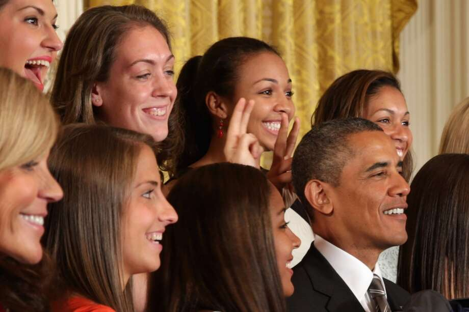 "WASHINGTON, DC - JULY 31:  The 2013 NCAA champion University of Connecticut Huskies Women's basketball players Stefanie Dolson (L) and Kiah Stokes (C) give President Barack Obama (R) ""bunny ears"" while the team poses for a photograph with the president in the East Room of the White House July 31, 2013 in Washington, DC. Obama hosted the team after they defeated the University of Louisville on April 9 to win their eighth national championship. (Photo by Chip Somodevilla/Getty Images) Photo: Getty Images"