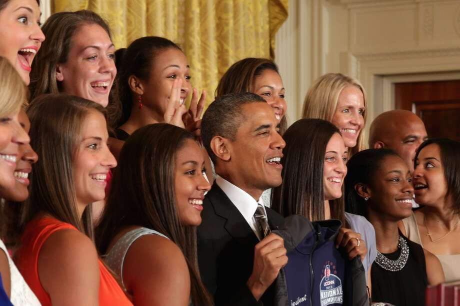 "WASHINGTON, DC - JULY 31:  The 2013 NCAA champion University of Connecticut Huskies Women's basketball players Stefanie Dolson (L) and Kiah Stokes (3rd L) give President Barack Obama ""bunny ears"" while the team poses for a photograph with the president in the East Room of the White House July 31, 2013 in Washington, DC. Obama hosted the team after they defeated the University of Louisville on April 9 to win their eighth national championship.  (Photo by Chip Somodevilla/Getty Images) Photo: Getty Images"