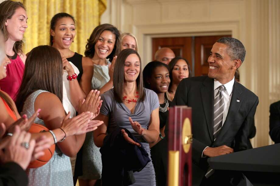 WASHINGTON, DC - JULY 31:  President Barack Obama (R) hosts the 2013 NCAA champion University of Connecticut Huskies Women's basketball players in the East Room of the White House July 31, 2013 in Washington, DC. Obama hosted the team after they defeated the University of Louisville on April 9 to win their eighth national championship.  (Photo by Chip Somodevilla/Getty Images) Photo: Getty Images