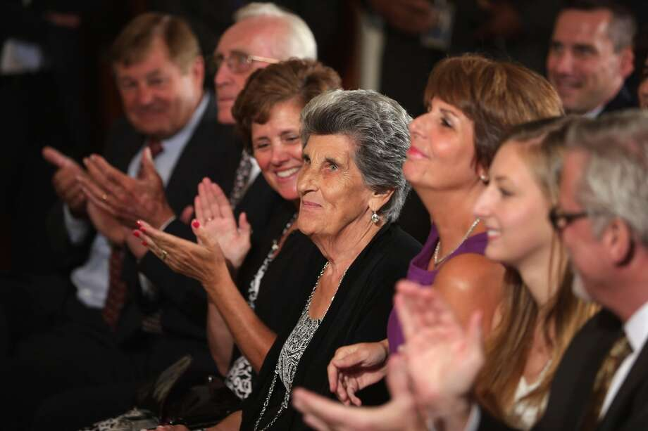 WASHINGTON, DC - JULY 31:  NCAA champion University of Connecticut Huskies Women's basketball head coach Geno Auriemma's mother, Marciella Auriemma (C), sits in the front row to watch her son's team being honored by President Barack Obama in the East Room of the White House July 31, 2013 in Washington, DC. Obama hosted the team after they defeated the University of Louisville on April 9 to win their eighth national championship.  (Photo by Chip Somodevilla/Getty Images) Photo: Getty Images