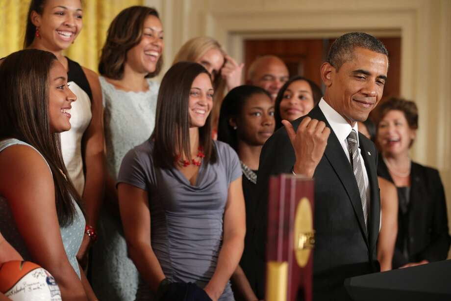 WASHINGTON, DC - JULY 31:  President Barack Obama (2nd R) hosts the 2013 NCAA champion University of Connecticut Huskies Women's basketball players in the East Room of the White House July 31, 2013 in Washington, DC. Obama hosted the team after they defeated the University of Louisville on April 9 to win their eighth national championship.  (Photo by Chip Somodevilla/Getty Images) Photo: Getty Images