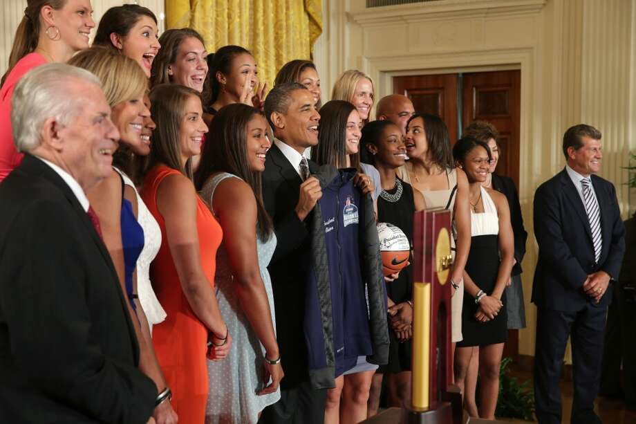 WASHINGTON, DC - JULY 31:  President Barack Obama (C) poses for photographs with the 2013 NCAA champion University of Connecticut Huskies Women's basketball team in the East Room of the White House July 31, 2013 in Washington, DC. Obama hosted the team after they defeated the University of Louisville on April 9 to win their eighth national championship.  (Photo by Chip Somodevilla/Getty Images) Photo: Getty Images