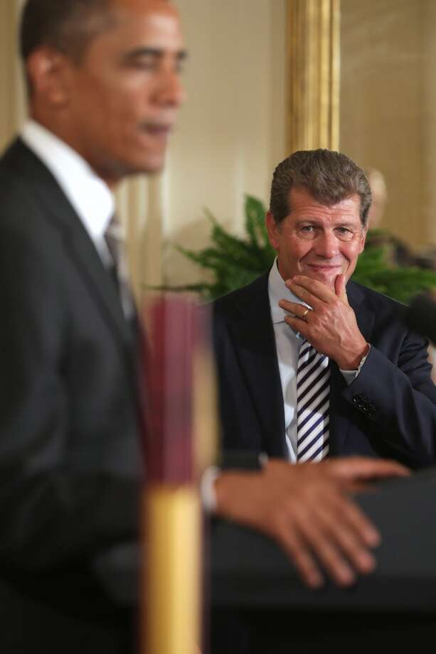 WASHINGTON, DC - JULY 31:  NCAA champion University of Connecticut Huskies Women's basketball head coach Geno Auriemma (R) listens as President Barack Obama hosts his team in the East Room of the White House July 31, 2013 in Washington, DC. Obama hosted the team after they defeated the University of Louisville on April 9 to win their eighth national championship.  (Photo by Chip Somodevilla/Getty Images) Photo: Getty Images
