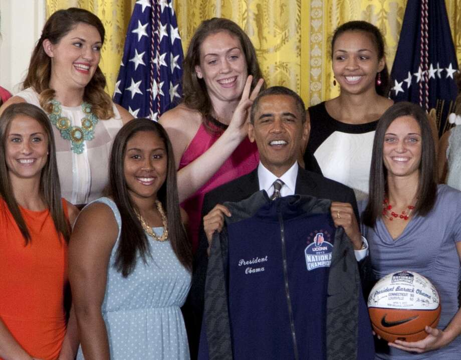 University of Connecticut Huskies basketball center Stefanie Dolson, top left, give the 'bunny ears' to President Barack Obama as he poses for photo with the team during a ceremony in the East Room of the White House in Washington, Wednesday, July 31, 2013, where the president honored their 2013 NCAA Women's Basketball Championship win. Also seen, from top left, Breanna Stewart, Kiah Stokes, bottom left, Caroline Doty, Kaleena Mosqueda-Lewis and Kelly Faris. (AP Photo/Carolyn Kaster) Photo: Associated Press