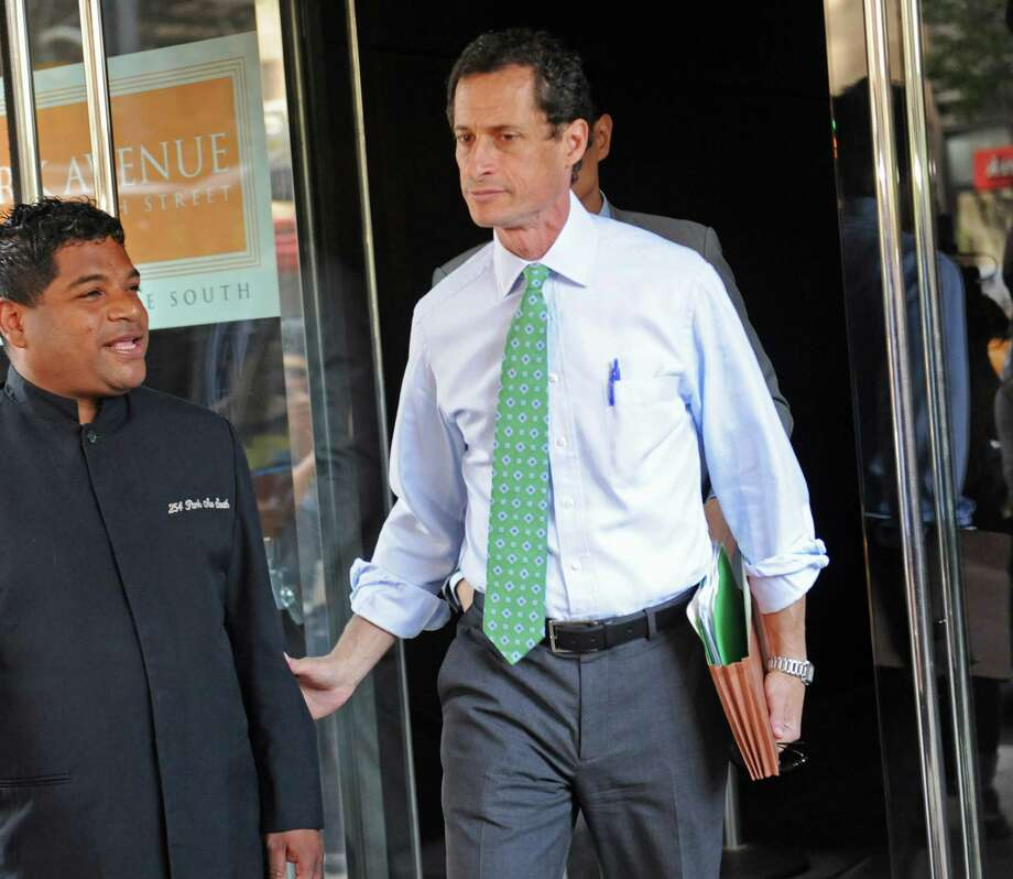 Anthony Weiner leaves his Park Avenue apartment, Wednesday, July 31, 2013, in New York. Despite the sexting scandal, Weiner is resistant to drop out of the New York City mayoral race. Photo: Louis Lanzano, Associated Press / FR77522 AP