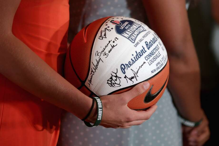 WASHINGTON, DC - JULY 31:  NCAA champion University of Connecticut Huskies Women's basketball players present President Barack Obama with a signed basketball during a ceremony in the East Room of the White House July 31, 2013 in Washington, DC. Obama hosted the team after they defeated the University of Louisville on April 9 to win their eighth national championship.  (Photo by Chip Somodevilla/Getty Images) Photo: Getty Images