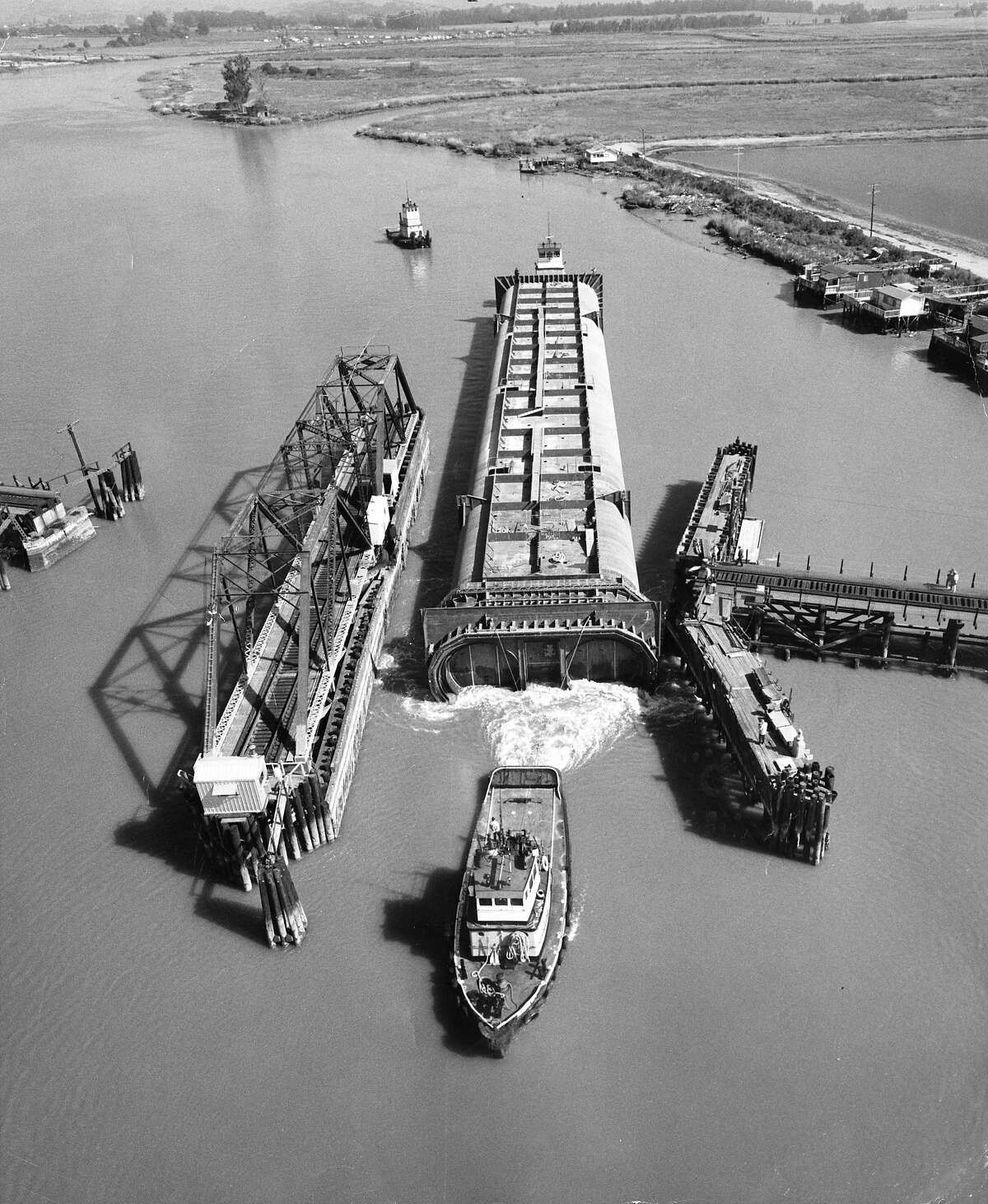 April 28, 1968: A section of the BART tube is towed down the Napa River after being fitted with a flexible seismic protection joint at Kaiser Steel's Napa plant.