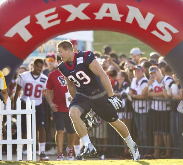 Texans defensive end J.J. Watt runs onto the practice field Wednesday.
