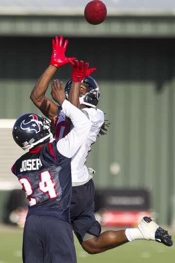 Cornerback Johnathan Joseph and wide receiver DeAndre Hopkins go up for a pass in the end zone.