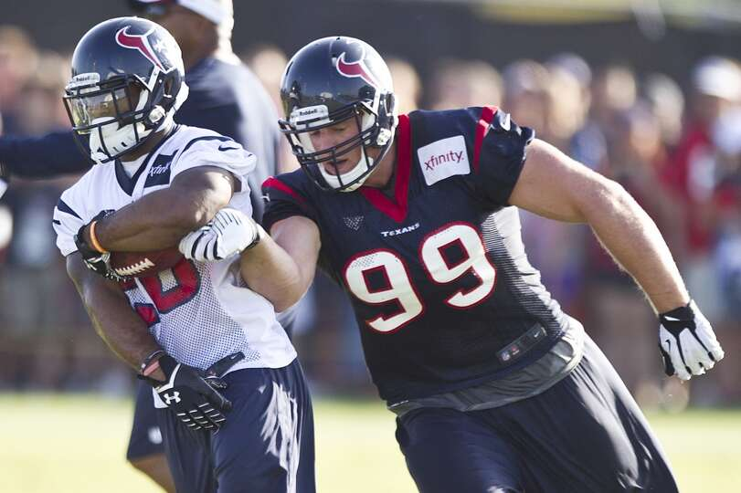 Running back Dennis Johnson is chased down by defensive end J.J. Watt.