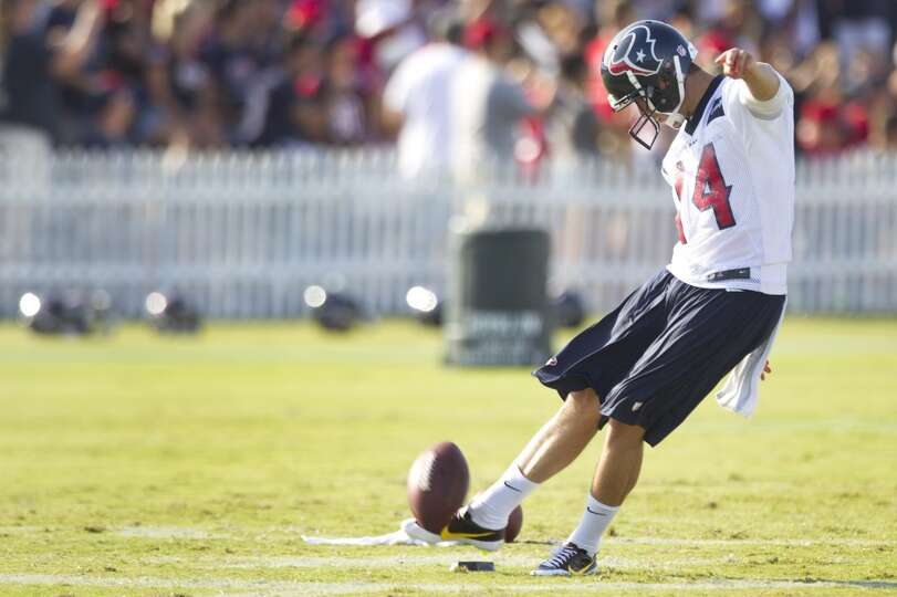 Punter Andrew Shapiro (14) kicks the ball.