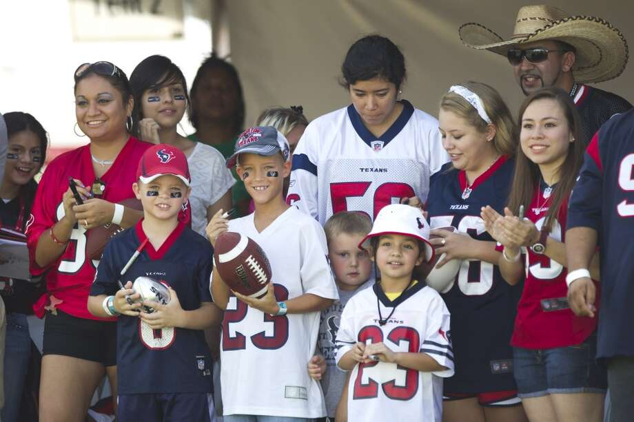 Texans fans watch practice. Photo: Brett Coomer, Chronicle
