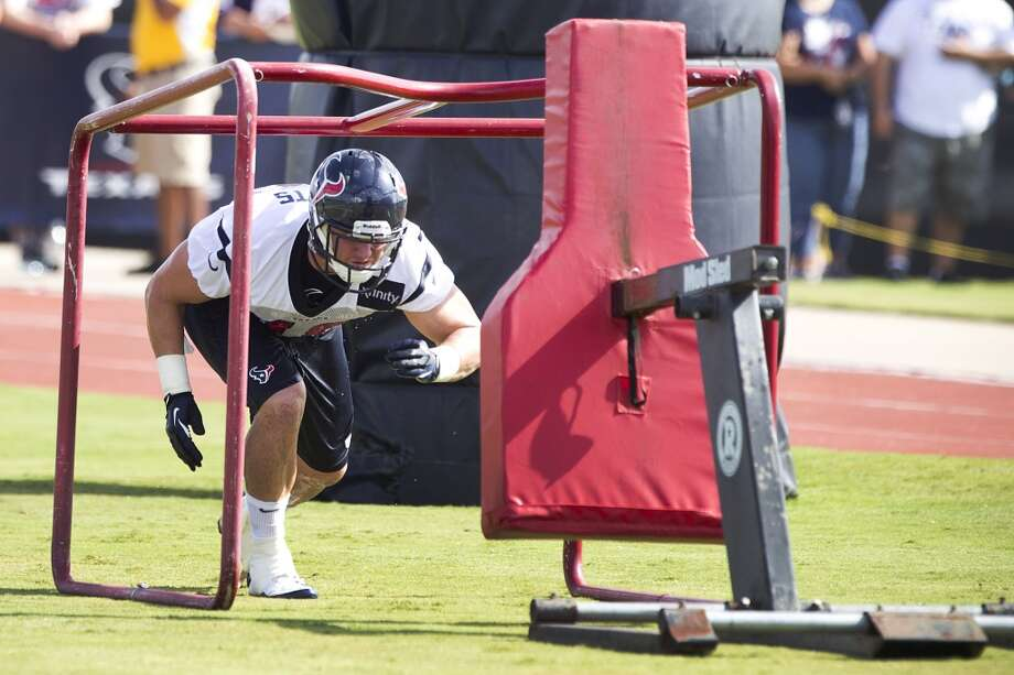 Fullback Tyler Clutts gets ready to hit a blocking sled after practice. Photo: Brett Coomer, Chronicle