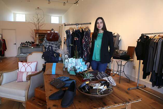 Marin  Carolina Boutique: Luxe everyday wear, from AG Jeans, Kooba, Theory, Velvet and Vince, is organized by vignettes that allow you to shop for a certain look, style or color at this second location. Owner Carolina Loiacono has added home items, including festive Champagne flutes, mercury glass candlesticks, cozy throws and Lollia bath and body products. 444 Ignacio Blvd. (Pacheco Plaza), Novato; (415) 883-4883, and 76 Throckmorton Ave., Mill Valley, (415) 381-2554. www.carolinaboutique.com. Photo: Liz Hafalia, The Chronicle
