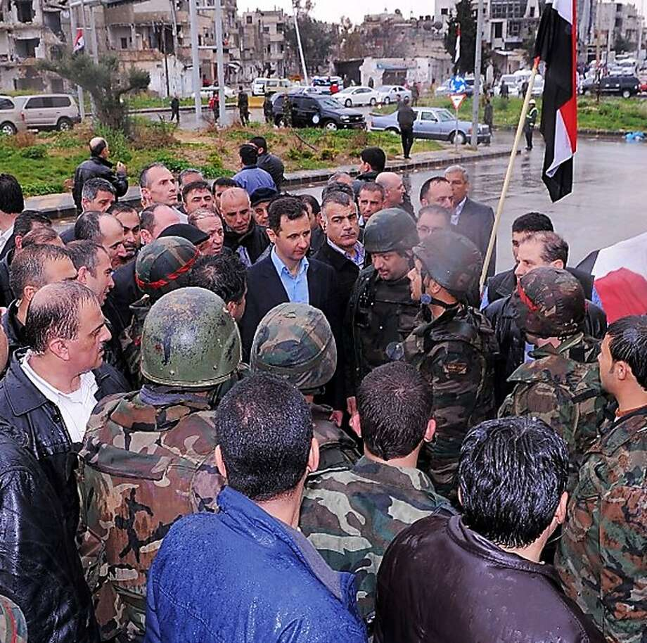 President Bashar Assad visits with Syrian soldiers in a picture posted on his Instagram account. Photo: Uncredited, Associated Press