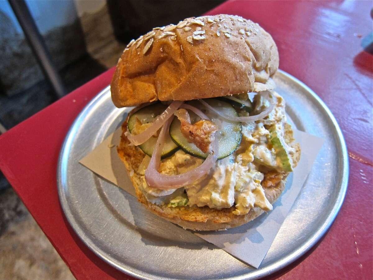 Slow Ride chicken salad sandwich with chicken skin cracklings at Eatsie Boys Cafe.