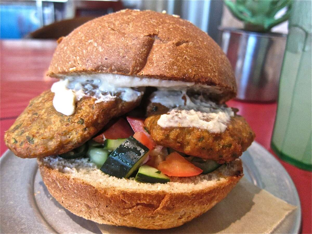 """""""What the falafel?"""" sandwich of house-made chickpea patties, tzatziki and Israeli salad at Eatsie Boys Cafe."""