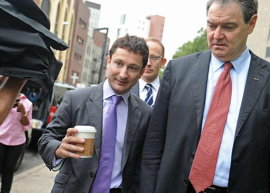 "Ex-Goldman Sachs trader Fabrice Tourre (left) with his lawyer John ""Sean"" Coffey. Photo: Louis Lanzano, Associated Press"