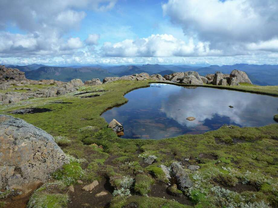 A reflective tarn just below the summit of Mt. Ossa. Photo: Adam Smith