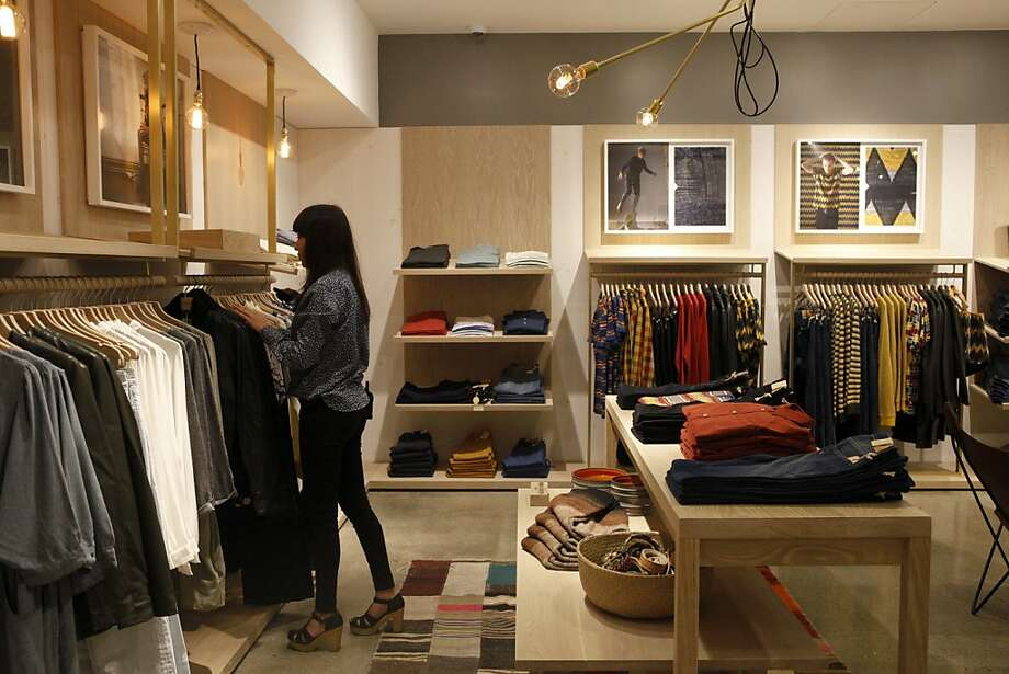 Jessica Gonzales organizes clothing displays at the new Levi's store on Market Street. Photo: Katie Meek, The Chronicle