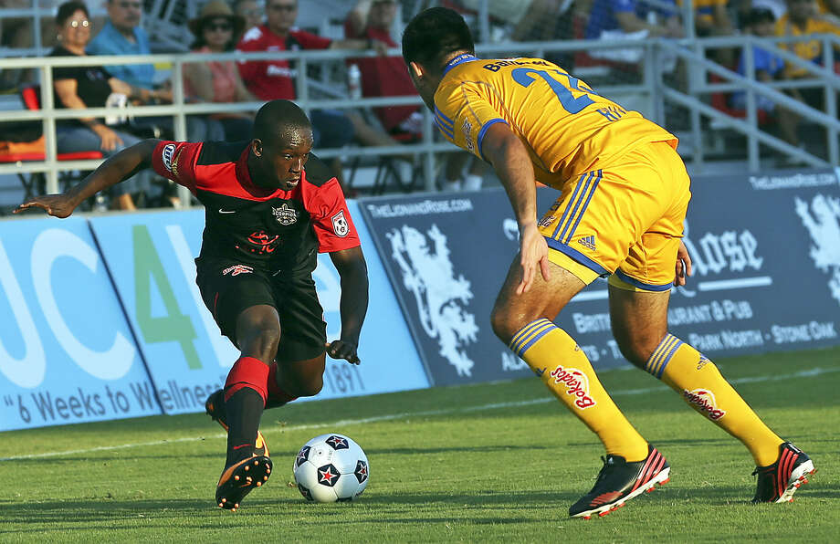 Fabrice Noel (left) sets the play from the right as the Scorpions host the UANL Tigres at Toyota Field on July 6. The Scorpions draw crowds averaging 7,000. Photo: Tom Reel / San Antonio Express-News