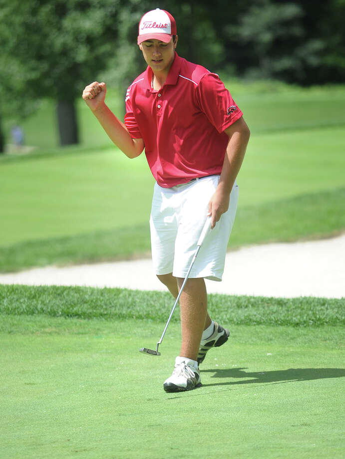 Tyler Mazut, of Fairfield, celebrates sinking a birdie putt on the 7th green to give him a 4-up lead in the finals of the Borck Jr. golf tournament at the Patterson Club in Fairfield, Conn. on Wednesday, July 31, 2013. Photo: Brian A. Pounds / Connecticut Post