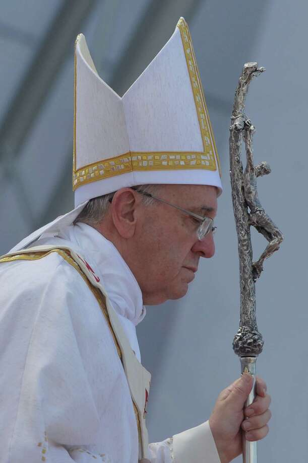 Pope Francis holds his papal crucifix during the World Youth Day's concluding Mass on the Copacabana beachfront in Rio de Janeiro, Brazil, July 28, 2013. Photo: LUCA ZENNARO, AP Photo/Luca Zennaro, Pool / Associated Press
