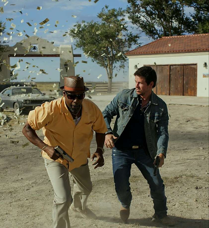 "DEA agent Denzel Washington and naval intelligence man Mark Wahlberg attempt to evade mayhem in ""2 Guns,"" a mess of an action thriller. Photo: Universal Pictures"