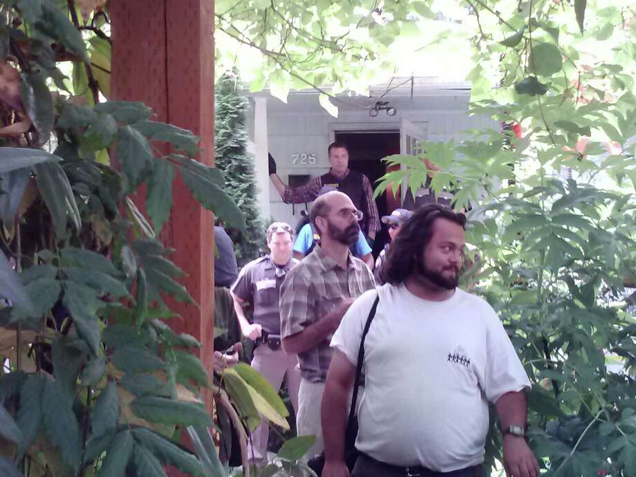 King County sheriff's deputies block the entryway Thursday afternoon of a South Park house where law enforcement evicted the home that was repossessed by banks. Photo: Lynsi Burton/seattlepi.com